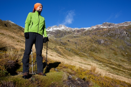 descend: Young woman hiking in the mountains