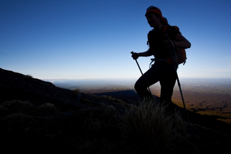 woman hiking: Silhoutte of a mountain hiker