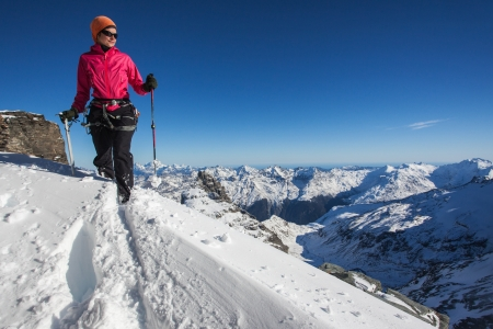 woman hiking: Young woman in the Alps in winter Stock Photo
