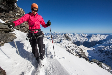 Young woman during winter mountain climb photo