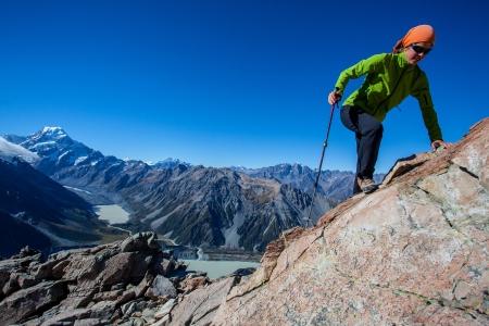 Youg woman climbing  mountain ridge in the Alps photo