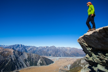 Youg woman high above the alpine valley photo