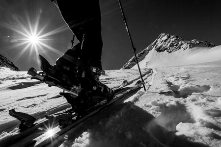 ascent: Skitouring - detail of a ski binding during winter mountain ascent