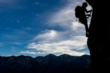 Silhouette of a climber high above mountains