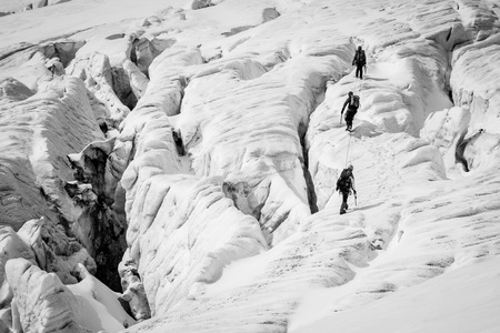 crevasse: Group of climbers on a glacier with dangerous crevasses