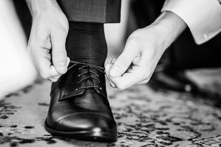 lacing: Detail of a business man lacing his shoes