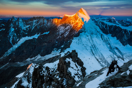 mountain climbing: Climber ascending the Lion ridge route (Liongrat) to Matterhorn (Monte Cervino) at dawn