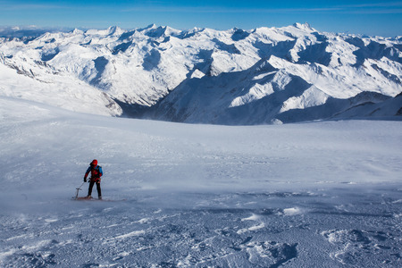 navigating: Winter panorama of the Alps with a climber navigating snow covered glacier
