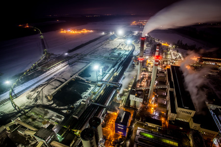 night shift: Aerial view of power plant complex at night Stock Photo