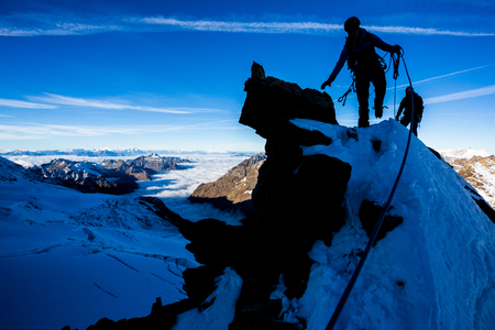 Silhouette of a mountaineer during morning ascent Stock fotó