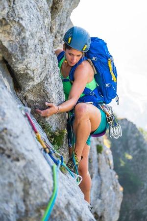 extreme sports: Young woman enjoying rock climbing Stock Photo
