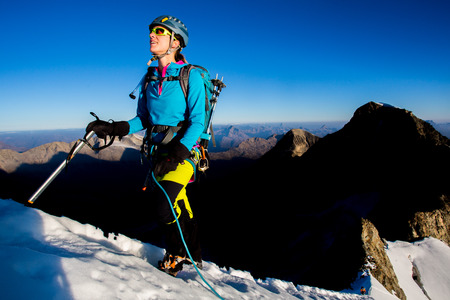 ascent: Young woman during mountain ascent
