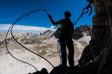 Silhouette of a climber during multi-pitch mountsin ascent