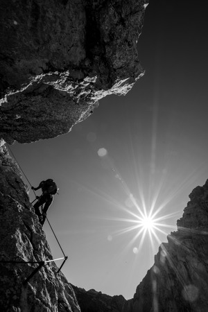 ascent: Silhouette of a climber during mountain ascent Stock Photo