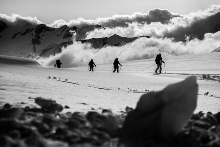 climb: Small group ascending the glacier with ski Stock Photo