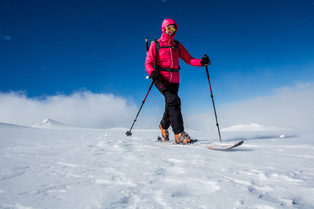backcountry: Young woman enjoying backcountry skiing Stock Photo