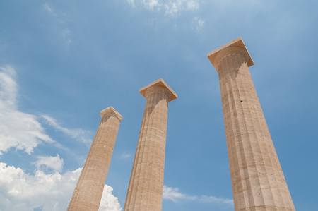 Remains of ancient columns in the Greek Doric Order.  Against blue sky. Greece.