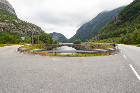 Open road. U-turn. Empty road with no traffic in countryside. Rural landscape. Ryfylke scenic route. Norway. Europe.