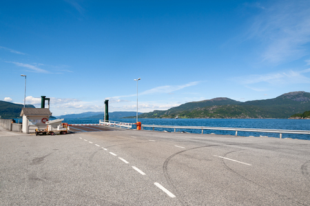 Open road. Ferry harbour, harbor. Empty road with no traffic in countryside. Rural landscape. Ryfylke scenic route. Norway. Europe.