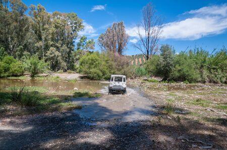 Rural Andalucia. Spain. 06102016. Riverbed crossing in 4x4 terrain vehicle. 版權商用圖片