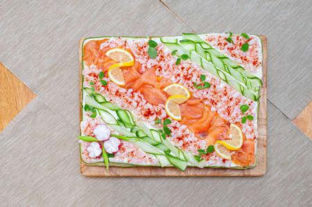 Smörgåstårta, Swedish sandwich like cake or sandwich torte is a dish with seafood ingredients like salmon, shrimps and prawns.