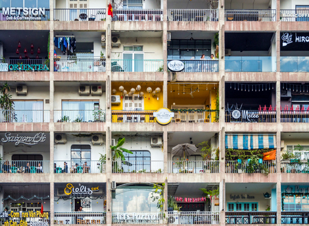 Saigon, Ho Chi Minh City, Vietnam, January 2017: [Apartment building with many flats and shops, Saigon Vietnamese living style in