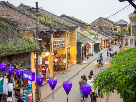 The old city of Hoi An in central Vietnam, old houses and lanterns of various colors, busy streets full of people Redakční
