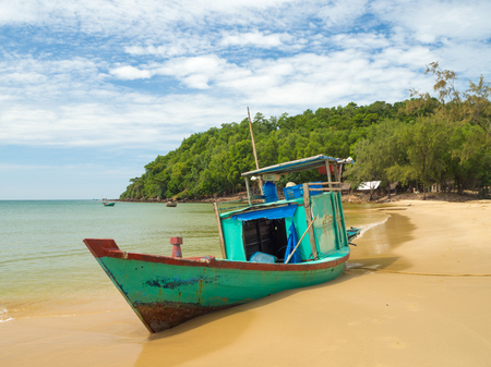 Fishing boat on the beautiful beach, Phu Quoc island with jungle behind, South Vietnam