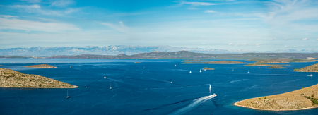 Aerial panoramic view of islands in Croatia with many sailing yachts between, Kornati national park landscape in the Mediterranean sea