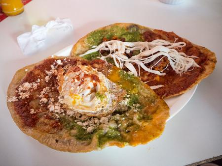 Puebla, Mexico, South America - January 2018: [Woman cooking memelas, tacos, quesadillas, Mexican street food]