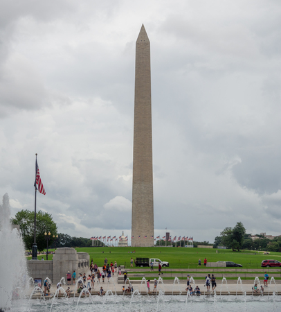 washington DC, District of Columbia, Summer 2018 [United States US, obelisk on the National Mall in the capital, Reflecting pool, falling dusk dark cloudy sky, reflection] Editorial