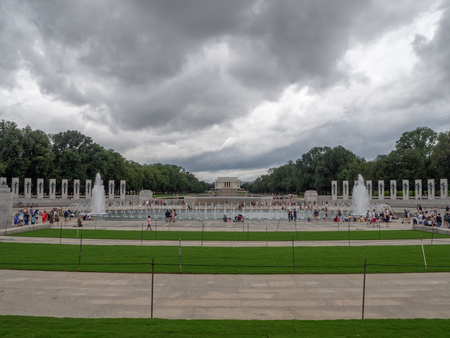 Washington DC, District of Columbia, Summer 2018 [United States US, World War II Memorial, park with Reflecting Pool, falling dusk, dark cloudy sky before rain]
