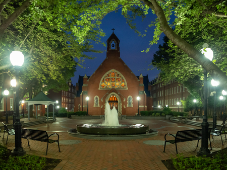 Washington DC, District of Columbia, Summer 2018 [United States US, Georgetown University at night, chapel and Healy Hall houses classrooms and the universitys executive body] Stock Photo