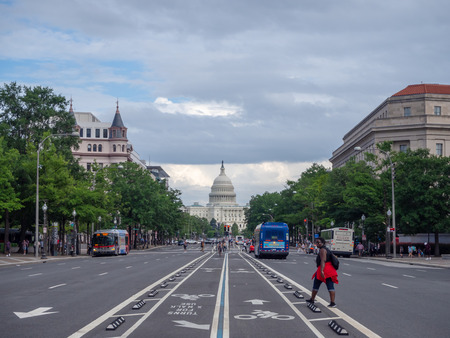 Washington DC, District of Columbia, Summer 2018 [United States US Capitol Building, shady cloudy weather before raining, faling dusk, street view]