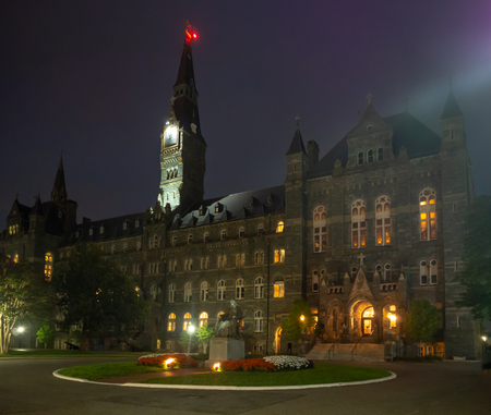 Washington DC, District of Columbia, Summer 2018 [United States US, Georgetown University at night, chapel and Healy Hall houses classrooms and the universitys executive body] Editorial