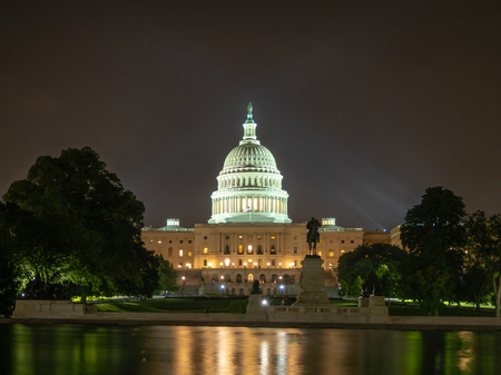 Washington DC, District of Columbia, Summer 2018 [United States US Capitol Building, night view with lights over reflecting pond, park fountain] Editorial