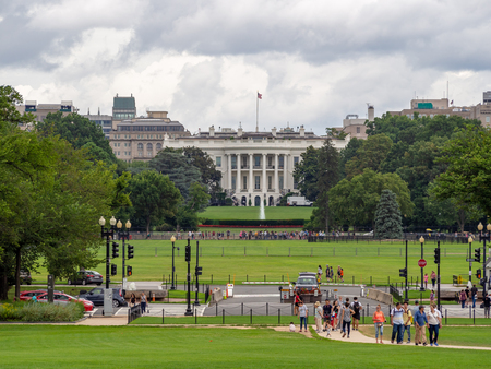 Washington DC, District of Columbia, Summer 2018 [United States US White House, lawn and garden behind the fence, touritst visitors in the street]