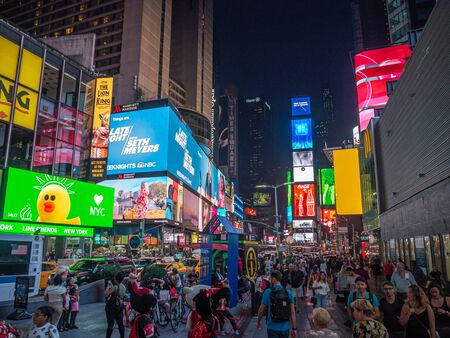 Midtown Manhattan, New York City, United States of America [ Times Square, crowded crossroad on Broadway, tourist attraction with advertisements ]