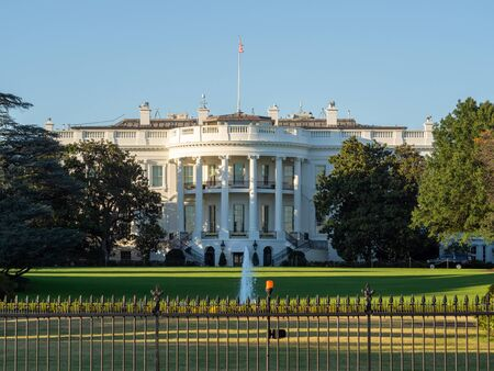Washington DC, District of Columbia, United States of America [ US White House, lawn and garden behind the fence, tourist visitors in the street ] Stock Photo