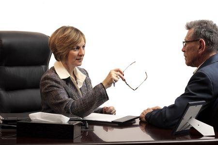 Woman executive coaching a male employee photo