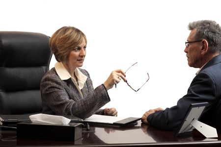 Woman executive coaching a male employee