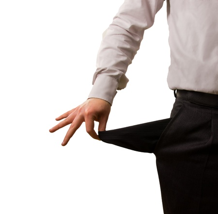 insolvency: A businessman pulling out his empty pocket Stock Photo