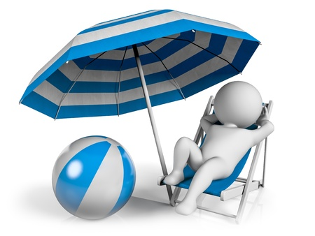 A person lying on a lounge chair enjoying his holiday under an umbrella at the beach photo