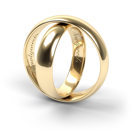 engraved: Gold wedding rings engraved with the text Newlyweds