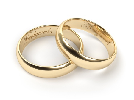 wedding rings: Gold wedding rings engraved with the text Newlyweds