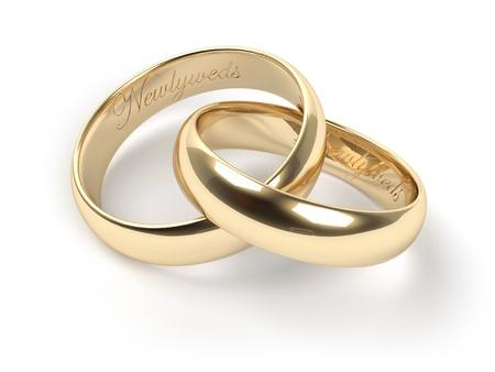 c�r�monie mariage: Anneaux de mariage en or grav�es avec les nouveaux mari�s texte Banque d'images