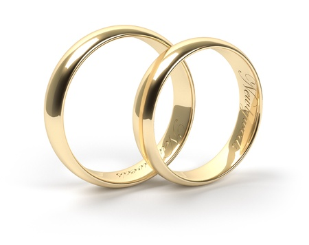 Gold wedding rings engraved with the text Newlyweds Stock Photo - 15870837