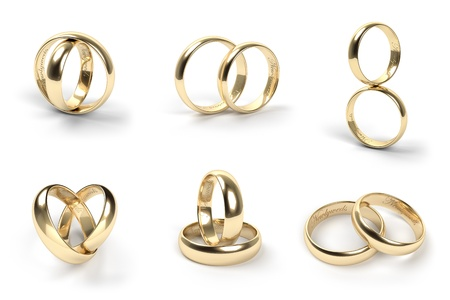 golden ring: Set of gold wedding rings engraved with the text Newlyweds