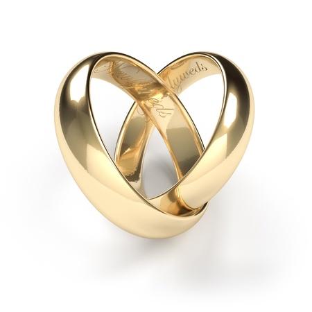 свадьба: Золотые обручальные кольца с выгравированным текстом Молодожены Фото со стока
