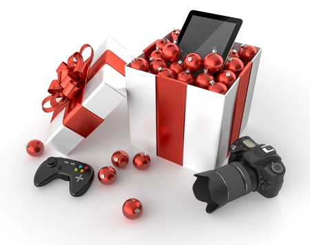 Gift box with a camera, a gamepad and a tablet surrounded by Christmas balls